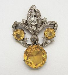 GOLD, SILVER, CITRINE AND DIAMOND BROOCH 3 citrines and 69 diamonds approx 19.25 & 2.00 cts.