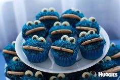 For our little boys first birthday, we went all out with the cookie monster theme.  From blue jelly cups, to cookie monster marshmallow pops -  and of course lots of chocolate chip cookies (cookie monster's favourite!)  Our son had his own individual cake (which he demolished!), but these red velvet cupcakes were made for the party guests to enjoy at the party, or take home.  I iced the cupcakes with blue buttercream frosting, then rolled them in tinted blue coconut.  They seemed to be a hit…