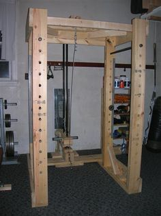 Homemade Power Rack and Lat Tower. Total cost was around $350.
