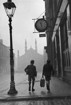 Bert Hardy Two boys walking along a street in the run-down Gorbals area of Glasgow. 1948