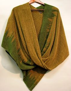 Twisted Shawls are mostly woven with a cotton warp and rayon chenille weft. Cost is $200. Some twisted shawls use bamboo, silk or space-dyed chenille and cost from $210 – $215. They are washable, on gentle cycle or simply freshened in a hot dryer (10 min) with a wet towel.  Click for Full Care   Click for Folding & Wearing instructions