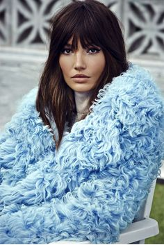 LIly Aldridge is a rockstar goddess in a blue shaggy fur coat and messy bangs for S Moda // Photo by David Roemer