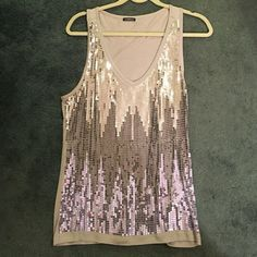 Silver and grey sequin tank top Perfect for the holidays! This shirt sparkles and shines. It has a chevron pattern with the different color grey/silver sequins. It's stretches in the back, so it can fit larger than a medium. Tops Tank Tops