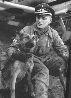 Luftwaffe pilot with dog comrade. He is often mistaken for Erich Hartmann.