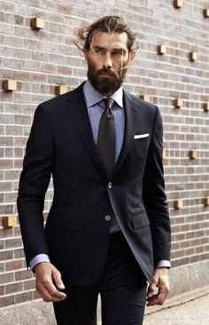 Shop this look on Lookastic:  http://lookastic.com/men/looks/light-blue-dress-shirt-black-tie-white-pocket-square-black-suit/9211  — Light Blue Chambray Dress Shirt  — Black Vertical Striped Tie  — White Pocket Square  — Black Suit