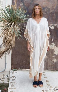 "Jamdani caftan with gorgeous intricate handwoven details and tassar silk border. Available in two lengths Color: Natural white with gold border - — Length 38"" or 49"" - — Handwoven cotton with Tassar s"