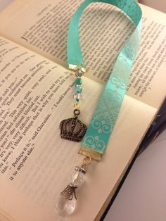Mint green ribbon bookmark handmade with crown charm and crystals repurposed from vintage jewellery. $15.00, via Etsy, shop/MikailaBelle