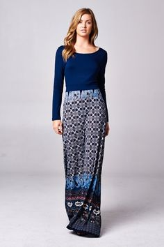 "Stunning colorblocked border print maxi dress. Scoop back. Self-tie in back. Long sleeves. Length: 62""."