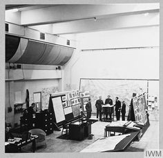Original wartime caption: The Air Officer Commanding-in-Chief, with his staff, plans the night's operations. Deep underground, the room is lofty, quiet suffused by a soft light shining from half-concealed reflectors. Its walls are lined with huge maps, charts and blackboards. Air Force Bomber, High Wycombe, Royal Air Force, How To Plan, The Originals, Blackboards, Room, Soft Light, Lancaster