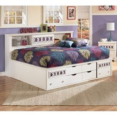 Full size sideways platform bed.