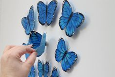 This set of 6 Blue 3 d canvas butterfly decals will brighten up any room. They add a special touch to any room, They will add accents to any childs room or nursery. This set also comes with 3 small free butterflies. Each butterfly measures in a range of 2 1/2 x 3 inches up to 3 x 3 inches each. The 3 small butterflies measure anywhere from 1 1/2 x 2 inches to 2 x 2 inches. This set of butterflies are painted in Ultra Deep Blue and Azure Blue. The accents are painted in Black. They have a…