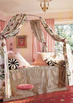 For Little Girls - An exuberant mix of patterns and colors inhabit this showhouse bedroom designed for a girl. Pink taffeta drapery panels sit cheerily on pink-and-green-striped walls. Even the wood floors join the fun with a layer of hot pink stain.