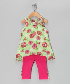 LOVE this!!This darling duo is a sure bet in a little lady's wardrobe. The colorful tunic touts a sleeveless silhouette and hi-low hem while the coordinating leggings feature an elastic-waistband for easy dressing and all-day comfort.Includes tunic and leggings100% polyesterMachine wash; tumble dry