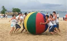 Pushball (what else would it be called?)  11 players compete to push a giant 6ft-high ball between two upright posts joined by a crossbar.