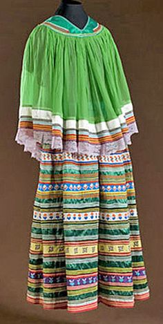 native american, America, A Seminole dress with the body of skirt in emerald green; bands are vibrant colors accented with narrow rickrack. ...