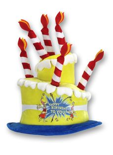 """This bright yellow velvet birthday cake hat is sure to make you smile. This whimsical cake is adorned with red - and white-striped candles, and an embroidered patch that says """"Happy Birthday to You!"""""""