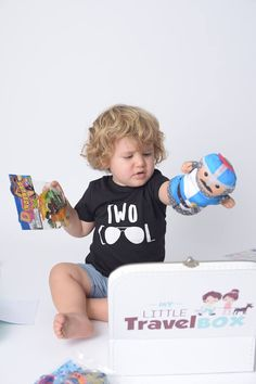 A baby is putting his toys in a suitcase. Baby Boy Photography, Children Photography, Baby Play, Baby Toys, One Year Old Baby, Qatar Doha, Joyful, Cute Babies, Suitcase
