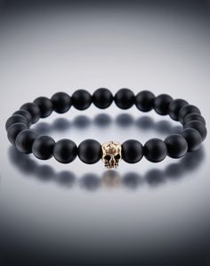 DyOh Spiritual Jewelry Collection - 8mm Matte Black Onyx With Gold Skull Bead Bracelet DYOH-8BLKONY-GSKULL