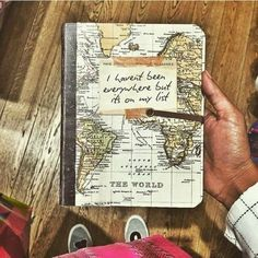▷ 1001 + Ideas for Adventure Journal Designs for Your Inner Traveler Travel diary, a brown hand holding a notebook, with a yellow and green world map on the front page, shoes, wooden boards Diy Photo, Travel Maps, Nice Travel, Travel Journals, Travel Destinations, Roadtrip Journal, Travel Album, Travel Books, Beach Travel