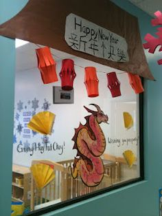 bulletin board chinese new year i like the banner roof and hanging lanterns i would get rid of the fans and dragon instead adding couplets to the left