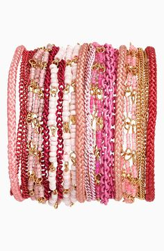 Pretty pink arm party.