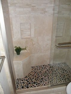 Pebble tile shower floor. Must have for my bathroom remodel! Perfect for the kids bathroom...