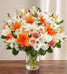 It's only natural to want to convey our sincerest feelings in a time of loss. Our bountiful, warm-hued bouquet features a lovely mix of peach roses, white lilies and orange carnations, hand-designed inside a classic clear glass vase. Spring Flower Arrangements, Vase Arrangements, Beautiful Flower Arrangements, Spring Flowers, 800 Flowers, Exotic Flowers, Orange Flowers, Orchid Flowers, Beautiful Flowers Pictures