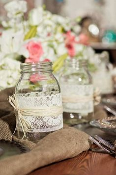 candles, mason jars with lace ribbon, burlap, neutral and wood tones mixed with soft florals in white and pink makes for a gorgeous center piece. it's all in the details!