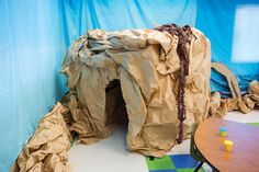 Preschool Cave: Cave Quest preschoolers will love crawling through their very own cave..complete with lights inside to show them they way! #cavequest