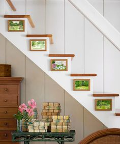 Hang small artworks on staircase risers—as shown here in Tony Shalhoub's home—for unexpected visual appeal.