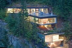 Modern slope house design, Canada...Surrounded by jaw dropping scenery...Wonder what would happen if there's a mudslide?