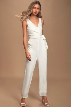 The Lulus Like It Like That White Sleeveless Surplice Jumpsuit is your one-and-done from day to night! Chic jumpsuit with surplice bodice and tie detail. Dressy Rompers And Jumpsuits, Jumpsuits For Women, Playsuits, White Jumpsuit Formal, Rehearsal Dinner Outfits, Wedding Rehearsal Dress, Cream Jumpsuit, White Outfits, White Romper Outfit