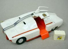 Spectrum Maximum Security vehicle from Captain Scarlet.Love the white and retro orange colour mixture. Slight aero-dynamic lines and the wonderfully gull-wing doors. 1970s Childhood, My Childhood Memories, Childhood Toys, Retro Toys, Vintage Toys, Scarlet, Gi Joe, Corgi Toys, Space Toys