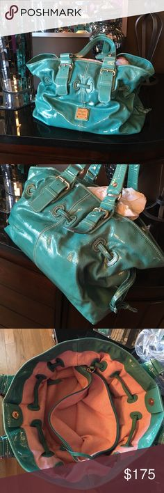 Dooney & Bourke Turquoise Medium Chiara Bag Great condition patent leather bag no longer available in stores. Great summer color! Always received lots of compliments when carrying it.  I have way too many purses and am trying to clear out some of them.  Corners and handles are in great condition without signs of wear.  There are a couple of pen marks (not sure if they would come out).  15Lx5Dx11H  Dust bag included.  Smoke free home. Dooney & Bourke Bags