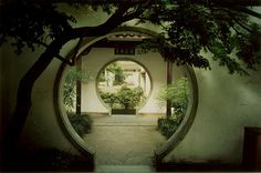 Series of circular doorways frame a tranquil garden. // Info provided by poster: While in Beijing, China, I went to a beautiful Taoist temple and park, and found the most beautiful door. It really gave the place a feeling of peace. More: frommoontomoon.bl... // Found by @RandomMagicTour (twitter.com/...) - Sasha Soren