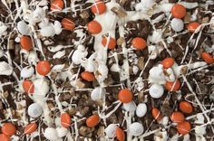 Campus Crunch Popcorn - A graduation gift that is sure to stand out! M's in their school colors and we add the popcorn, milk chocolate toffee bits, milk chocolate and dreamy white.