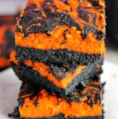 Halloween Swirl Cream Cheese Brownies have a layer of rich, dark chocolate brownie topped with a layer of orange cheesecake then swirled together for a spooky treat. These are sure to be a perfect dessert treat for everyone at your Halloween party! Halloween Brownies, Halloween Desserts, Creepy Halloween Food, Fun Halloween Treats, Spooky Treats, Halloween Appetizers, Halloween Foods, Easy Halloween, Halloween Buffet
