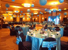 malibu blue wedding with lighted lanterns