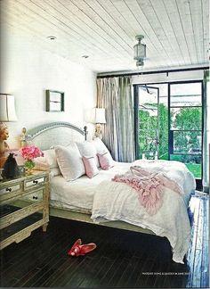 color palette, linen headboard, mirrored nightstand, rustic bedroom, wood floors.