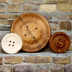 Giant wooden wall buttons. Love!