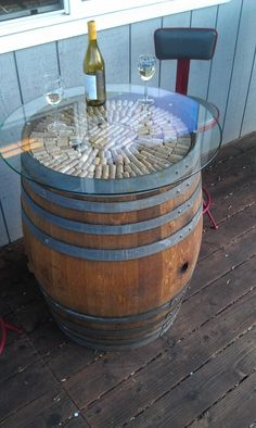 Vintage Wine For the BBQ area but with the glass recessed in. Wine barrel table- love the corks in it! Table Baril, Tonneau Bar, Wine Barrel Furniture, Wine Barrel Table Diy, Whiskey Barrel Table, Wine Barrel Bar Stools, Wine Table, Barris, Barrel Projects