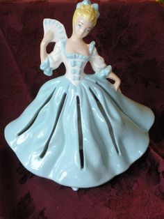 Know what this is??? She's a Napkin Doll. Napkins are placed through the slits in her skirt and she becomes a napkin dispenser. Love her. So elegant, so vintage.  @Etsy $55.