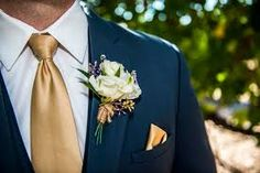Image result for blue suit gold tie
