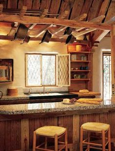Primitive ladder serves as a wonderful decorating accent in the kitchen!
