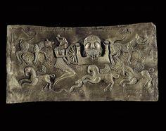 The god Taranis and a man holding a wheel, and various animals. Gundestrup cauldron, inner plate. Embossed silver, gilded (1st BCE) La Tene iii. National Museum, Copenhagen, Denmark