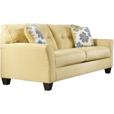 Featuring rounded track arms, tapered block legs, and bright upholstery, this sofa accents your den or living room in airy appeal. Pr...