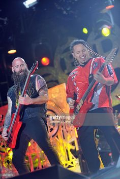 Zoltan Bathory and Chris Kael of Five Finger Death Punch performs during the 2014 Louder Than Life Festival at Champions Park on October 5, 2014 in Louisville, Kentucky.