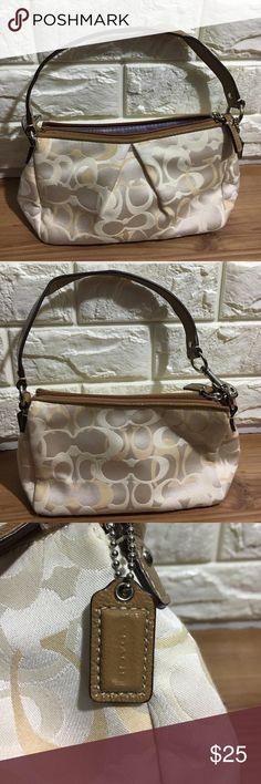 Small Coach bag or wristlet Mini bag or wristlet in Coach signature jacquard with patent leather strap and silver hardware... so cute! Coach Bags Mini Bags