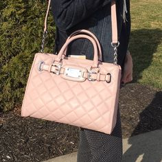 """✨MICHAEL KORS quilted Hamilton tote Perfect spring & summer bag!  100% AUTHENTIC MICHAEL KORS medium Hamilton quilted leather east/west tote in Blossom pink color.  38"""" Adjustable / Silver Chained Shoulder Strap, 4"""" Double Tote Handles.  Silver Tone Hardware.  Protective feet.  Interior: Three Slip Pockets, One Cell Phone Pocket, one zippered pocket, center zip compartment (padded to protect device such as iPad mini).  Dimensions: 13""""W x 5.5""""D x 9""""H.  Brand new with tags!  Stunning bag…"""