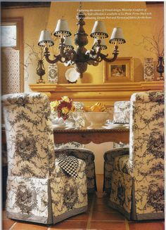 Parsons chairs in black toile. Like the checked napkins but the lampshades are just too much. Plain black would be better.  IMHO!